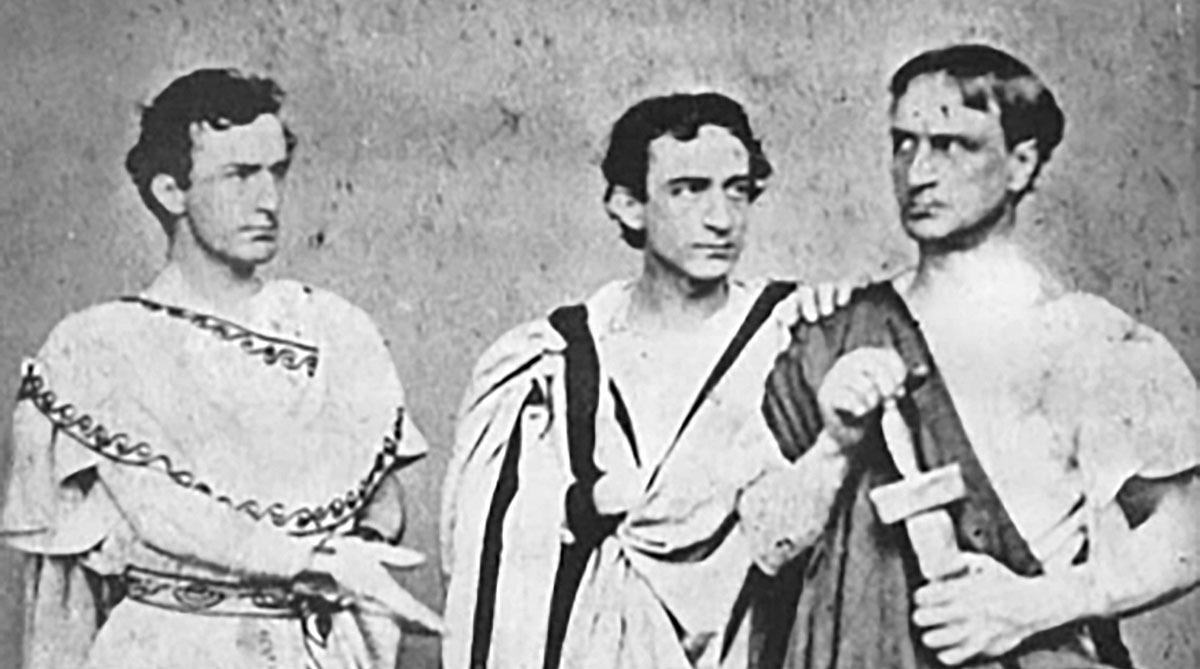 A black and white photograph of the Booth brothers in