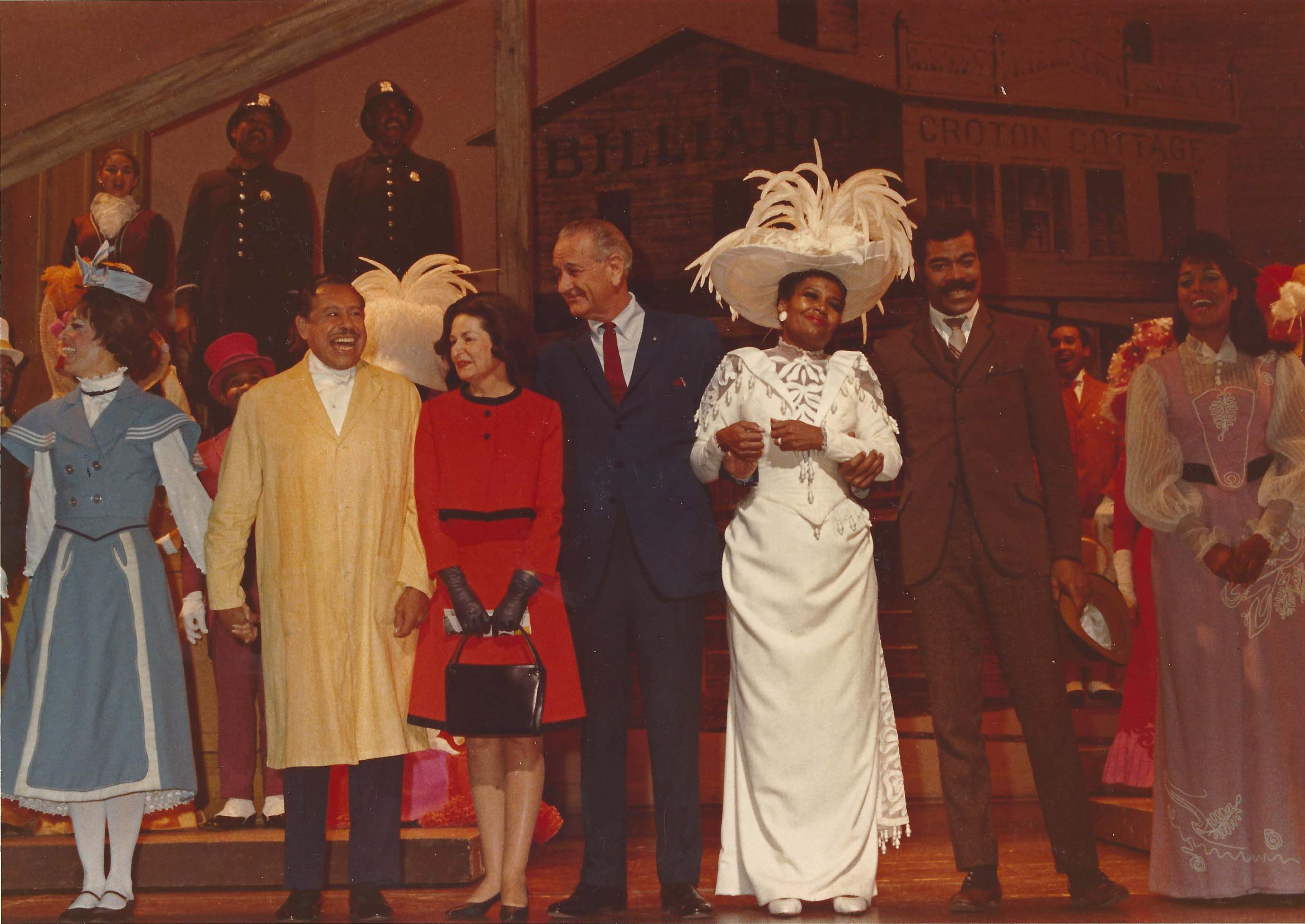 President Lyndon B Johnson and actress Pearl Bailey take a bow with the cast of Hello Dolly!