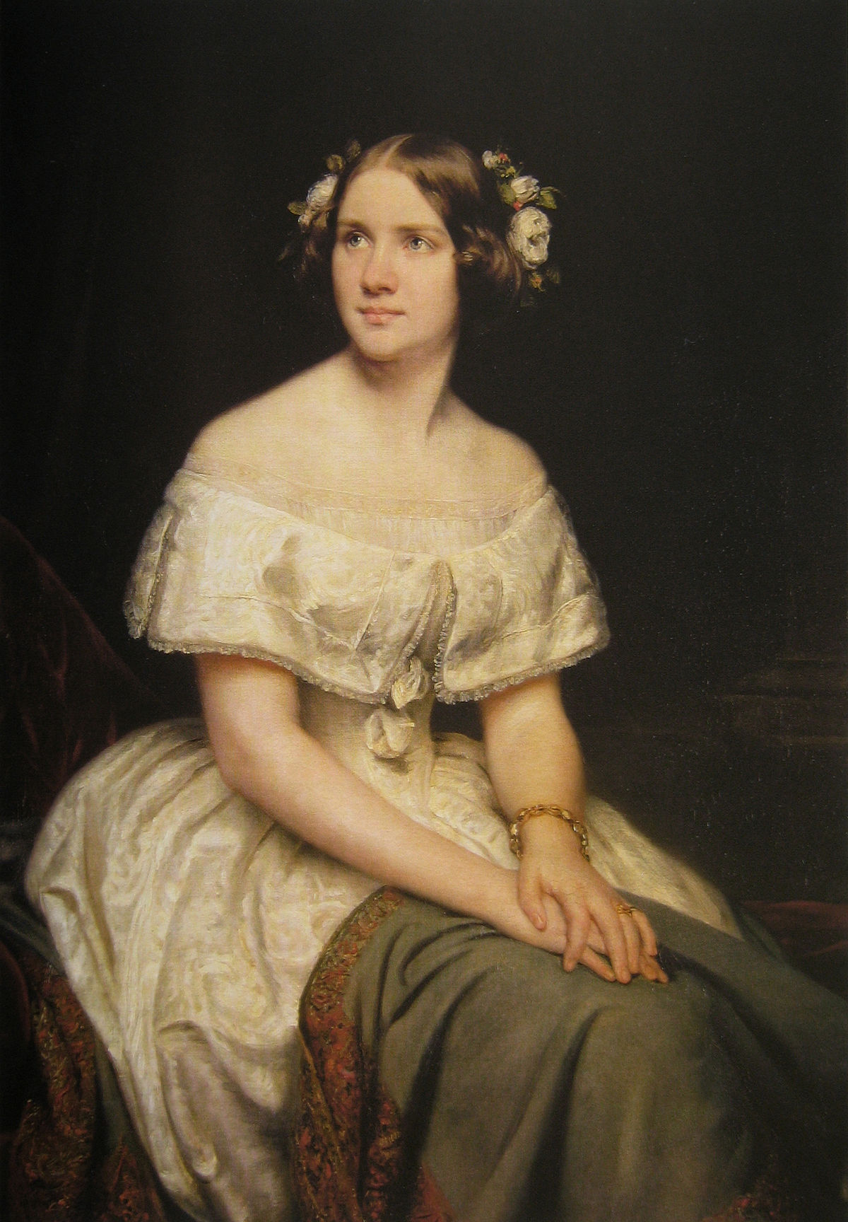 A painted portrait of Jenny Lind, seated with hands folded on her lap.